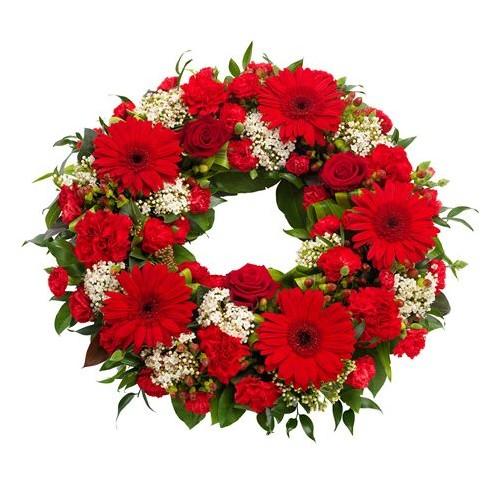 Corona de gerberas, rosas y claveles